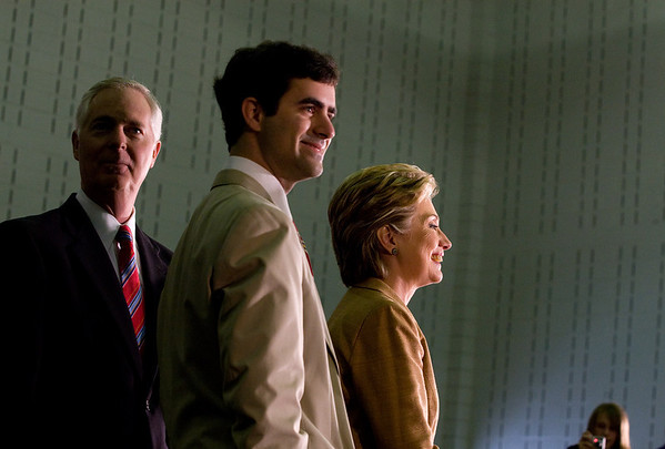 North Carolina Gov. Easley, left, and son, center, take the stage with presidential candidate Hillary Clinton during a rally at Pitt Community College.