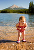 My brave little granddaughter at Honeymoon Lake, Jasper National Park, Alberta, Canada.<br /> The water was icy, but she still went for a paddle!