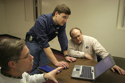 Jonathan Sivier, Mark Joseph and Lon Westfall study features of RockSim at the February 6, 2006 CIA membership meeting. Photo by Greg Smith.