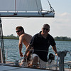 Father and son crossing a sailboat race finishing line