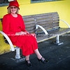 One woman in red dress and hat