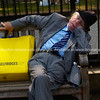 London man fall asleep at bus stop after shopping.<br /> <br /> Model Release; No. Editorial or personal use only.