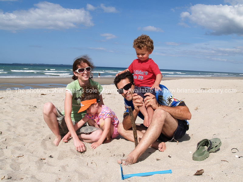 Young family at Papamoa beach