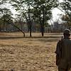 Armed Zambian nature park guardian searching for poachers.