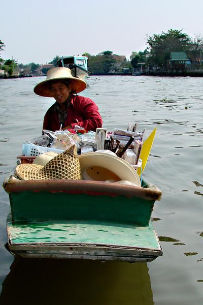 Thai seller in floating markets.