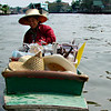 Thai seller in floating markets.