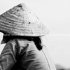 Vietnamese Woman in coolie hat, from back. Black and white.