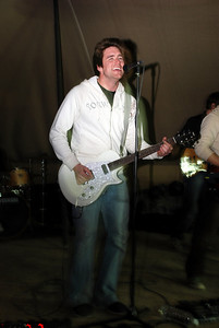 Christian Schauf of the band Catchpenny playing a show in Iraq   Check them out at www.catchpennyband.com  (2009).