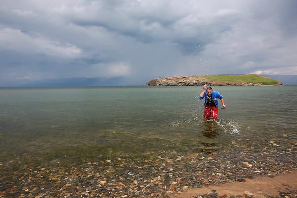 Spanish traveler takes dip in lake Baikals cold waters.