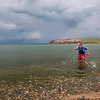 Spanish traveler takes dip in lake Baikals cold waters.
