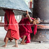 Young monks play under Mingun Bell.Myanmar Travel Images