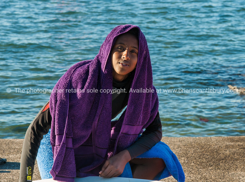 Boy under purple towel, at Kuim Park Beach windsurfing lessons.<br /> <br /> Model release; NO Model Release; No. Editorial or personal use only.