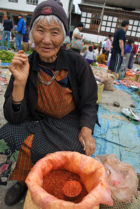Selling ground chili at the market in Paro, Bhutan.