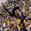 ECU Senior Tim Rugg and friends cheer the Pirates to victory in Saturday's game against Memphis.  Rugg hasn't missed a game in 5 years.  (Jenni Farrow)