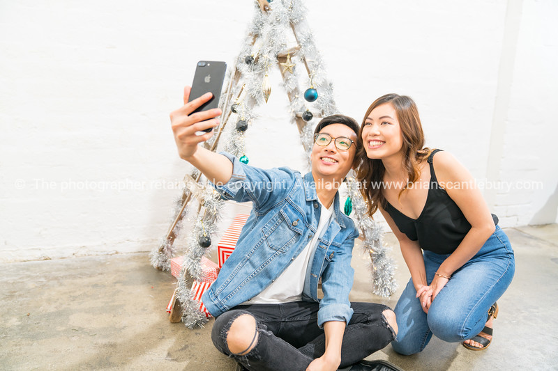 Young couple, Christmas theme.