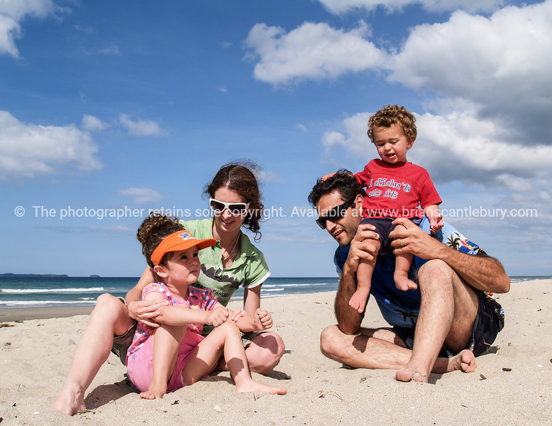 Family at beach.<br /> Model release; YES. Model Release; No. Editorial or personal use only.