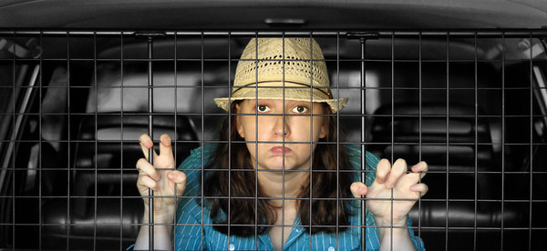 My sister behind the cargo cage in our old Volvo
