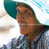 Vietnamese Man in blue hat.
