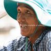 Vietnamese Man in blue hat.