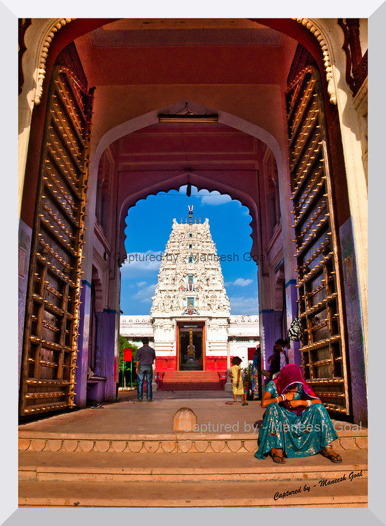A pilgrim rests outside the New Rangji Temple in the holy city of Pushkar, Rajasthan