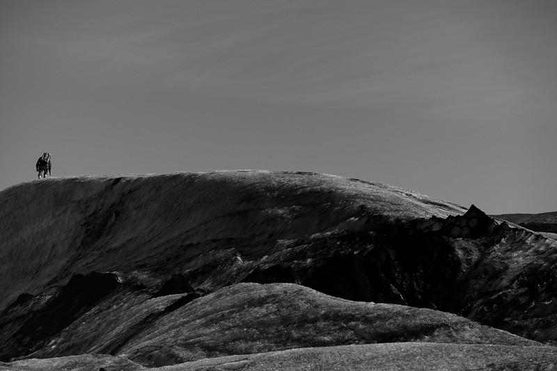 A man hikes on the Sólheimajökull glacier