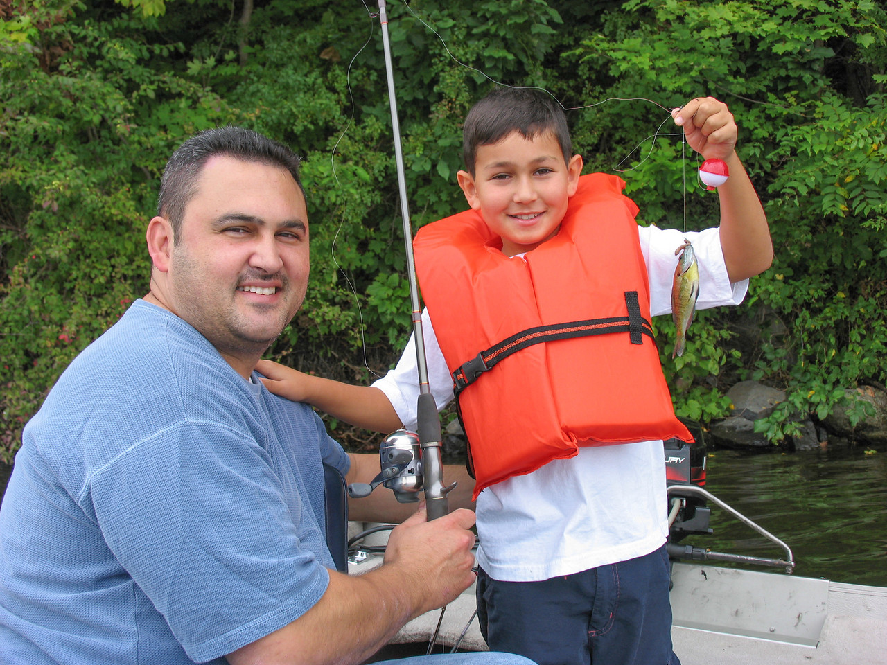 Gaets Termini and son, Austin displaying his first fish! August 2004