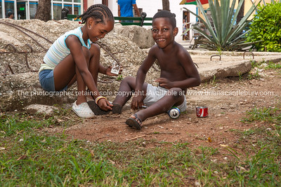 Children playing with makeshift toys in Havana street. Model Release; No. Editorial or personal use only.