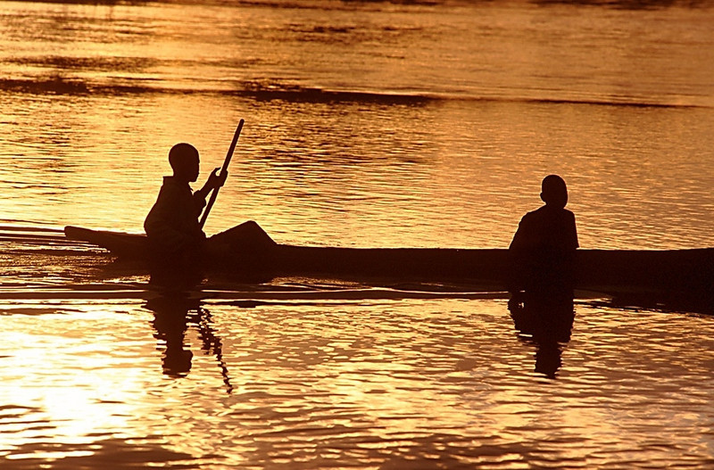 Boys in Dugout Canoe, Popa Falls, Namibia