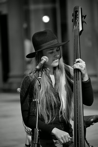 A musician in Bergen, Norway, playing Neil Young covers on a stand up bass