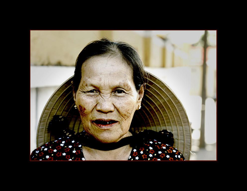 Old woman chewing Betelnut, Hoi An, Vietnam