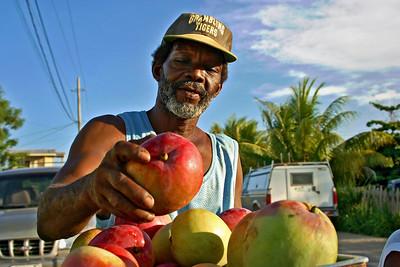 Selling mangoes in Dangriga, Stann Creek, Belize