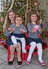 Big sister Kate with Kara and baby sister, Alexandra, in front of their Christmas Tree, December 2014.