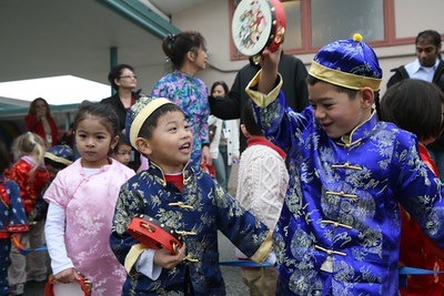 At College Park Magnet School in San Mateo, students from the mandarin pre-school / kinder class play as they wait to start the parade.  A Chinese Dragon with dancers from the Shaolin Cultural Center in San Mateo paraded with the students through the school.  It was all part of a dedication ceremony for the opening of its new World Language Laboratory.  The school's addition was made in part by a donation from the Taipei Economic Cultural Office.  Part of the festivities also included a presentation of Chinese performers.