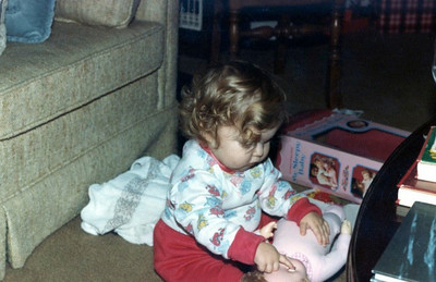Molly playing with doll, January '83