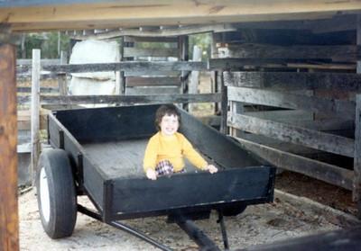 Betsy in Pop's cart at his barn, 1981