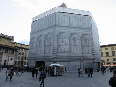 The Baptistery in front of the church, currently covered for renovation.