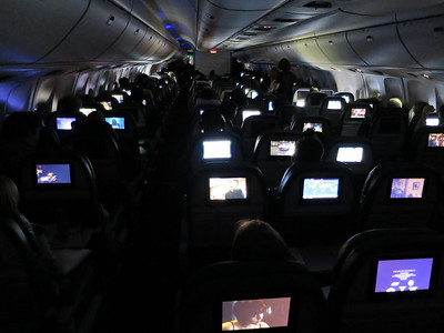 Our overnight flight; many of us now heading to Frankfurt, Germany. ... The stewards let us watch TV all night long!