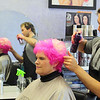 Kathy DiRusso since 2005 has been the Team Captain of The Cup Crusaders and each year she gets her colored pink by Stylist James Schneider at HairXotica, in the Johnny Appleseed Plaza on Route 12/Central Street. the pink is for breast cancer which her team raises money for.  James puts the final touches on her hair on Thursday at the salon. SENTINEL & ENTERPRISE/JOHN LOVE