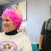 Kathy DiRusso since 2005 has been the Team Captain of The Cup Crusaders and each year she gets her colored pink by Stylist James Schneider at HairXotica, in the Johnny Appleseed Plaza on Route 12/Central Street. the pink is for breast cancer which her team raises money for.  James and Kathy have a good laugh as they check out her hair after it was done on Thursday. SENTINEL & ENTERPRISE/JOHN LOVE
