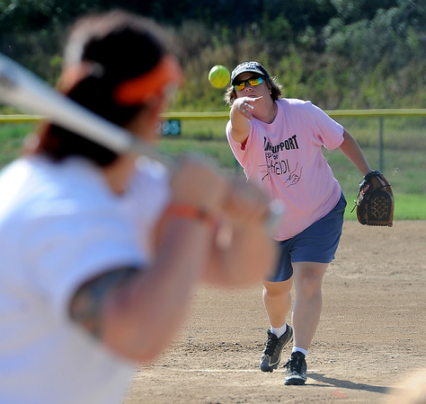 "Heidi Muller, cancer survivor and member of the Playball Bunnies, pitches on Sunday. <br /> Isabelle Crouse started a softball tournament 4-years ago to fight breast cancer after her teammate, Heidi Muller, contracted the disease. Proceeds go individuals and the Boulder Community Hospital Cancer Research Foundation.<br /> For more photos and a video of the game, go to  <a href=""http://www.dailycamera.com"">http://www.dailycamera.com</a><br /> Cliff Grassmick / August 21, 2011"