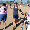"Jen McLaughlin greets teammates after scoring in the first inning.<br /> Isabelle Crouse started a softball tournament 4-years ago to fight breast cancer after her teammate, Heidi Muller, contracted the disease. Proceeds go individuals and the Boulder Community Hospital Cancer Research Foundation.<br /> For more photos and a video of the game, go to  <a href=""http://www.dailycamera.com"">http://www.dailycamera.com</a><br /> Cliff Grassmick / August 21, 2011"