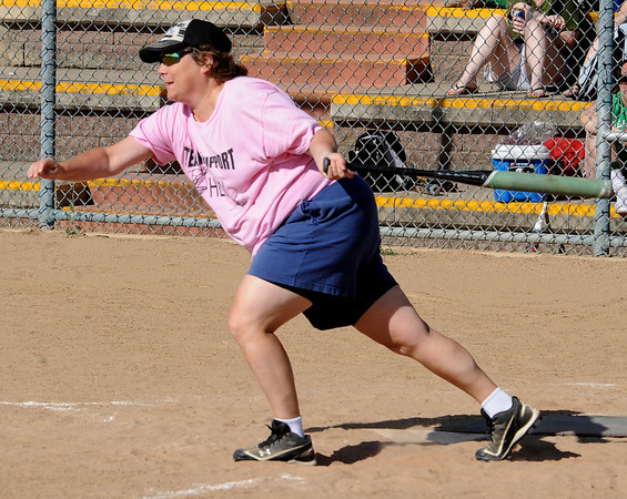 "Heidi Muller of the Playball Bunnies gets a hit.<br /> Isabelle Crouse started a softball tournament 4-years ago to fight breast cancer after her teammate, Heidi Muller, contracted the disease. Proceeds go individuals and the Boulder Community Hospital Cancer Research Foundation.<br /> For more photos and a video of the game, go to  <a href=""http://www.dailycamera.com"">http://www.dailycamera.com</a><br /> Cliff Grassmick / August 21, 2011"