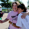 "Cancer survivor, Heidi Muller, left, gets a hello hug from Isabelle Crouse.<br /> Isabelle Crouse started a softball tournament 4-years ago to fight breast cancer after her teammate, Heidi Muller, contracted the disease. Proceeds go individuals and the Boulder Community Hospital Cancer Research Foundation.<br /> For more photos and a video of the game, go to  <a href=""http://www.dailycamera.com"">http://www.dailycamera.com</a><br /> Cliff Grassmick / August 21, 2011"