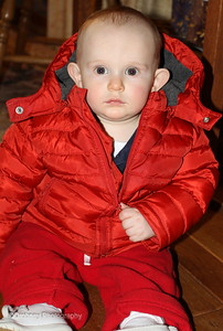 Marky, all bundled up and ready to go home.  Red is his color!  ;-)