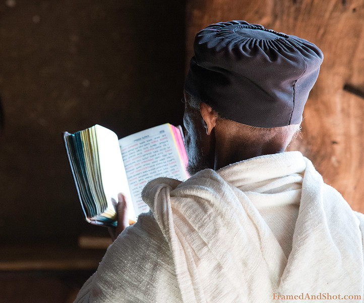 The Priest is reading