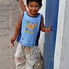 <strong><center><b>El Niño</strong><br> Met this charming little boy in Guanajuato, Mexico. He is eating a candy stick, he is just as dirty and untidy in that adorable way only children can get away with, and he was just a little bit shy – stopped; watched me and smiled – Hard to resist a smile like that!
