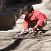 <b><center><em> Little boy playing on a side street in Marrakesh.