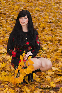 Beautiful elegant young woman and autumn colors.
