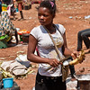 <strong><center>Fast Food Lady<br> Everyone need some fastfood every now and then, also in Angola – this is angolan fast food, grilled plantains (the big bananas) on a road side in the Malanje Province.