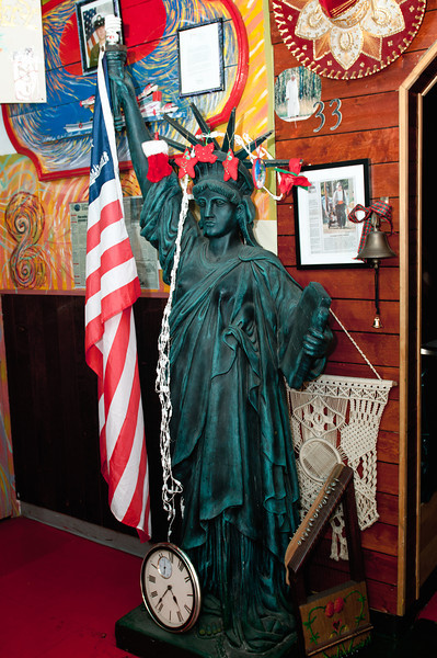 Lady Liberty watches over diners.